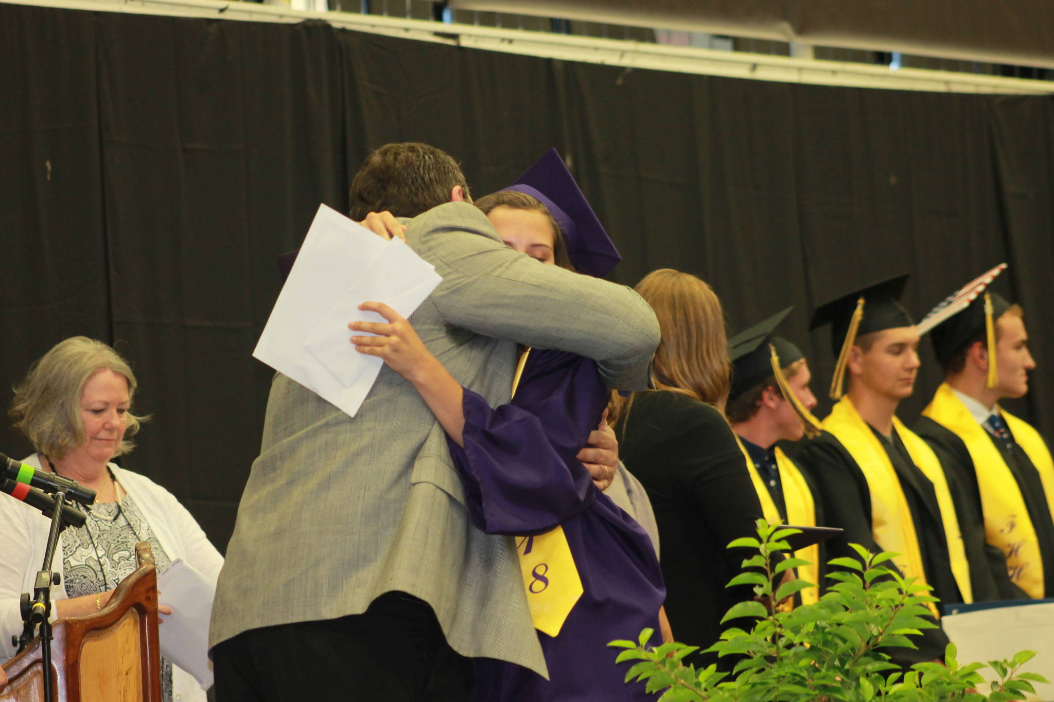 Staff photo/Heather Spaulding. Principal Fred Woods hugs daughter Kiana Woods.