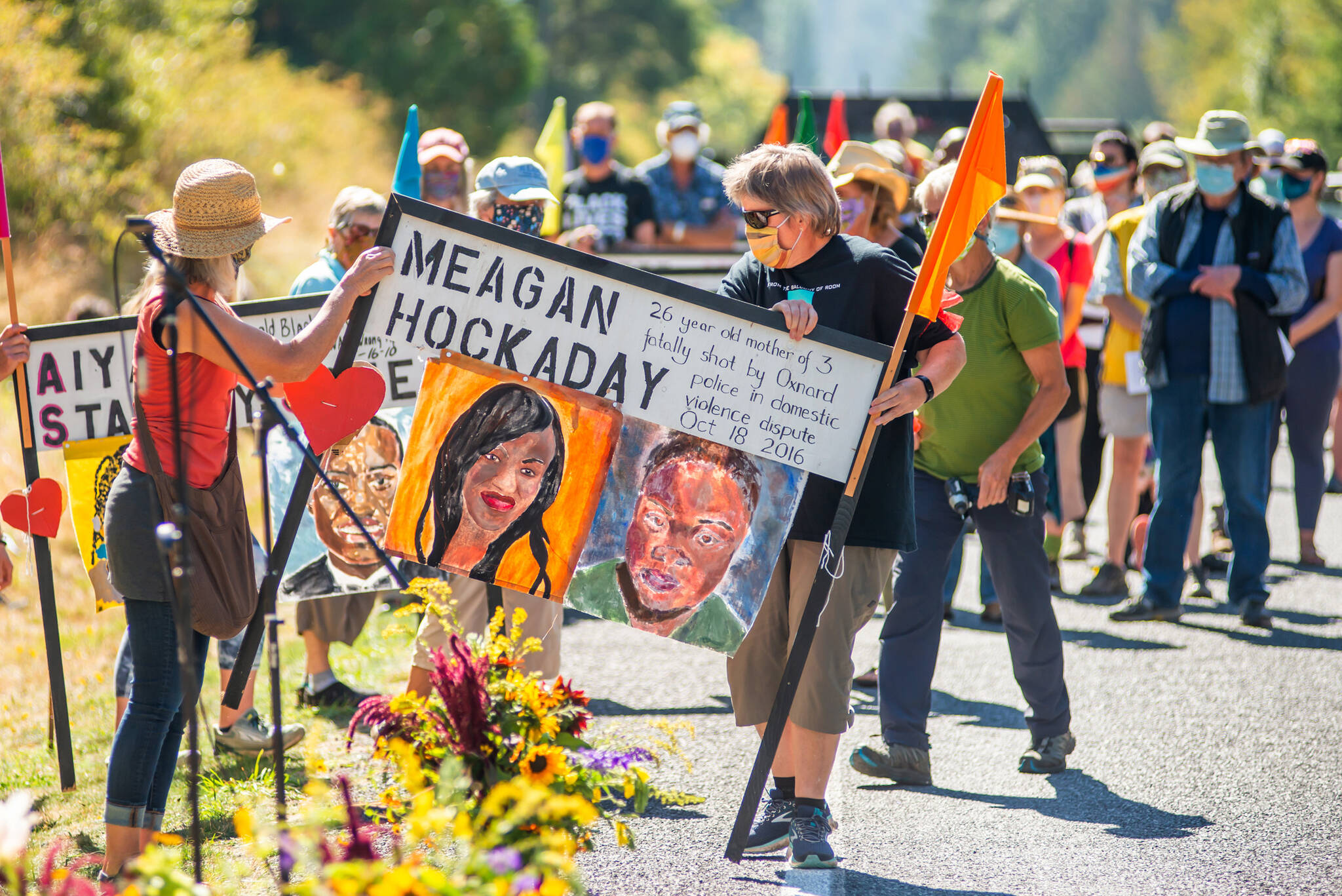 Lopezians gathered to honor Black lives lost as they respectfully removed memorial signs along the side of Fisherman Bay Road on Sept. 6, 2020. (Robert S. Harrison/contributed photo)